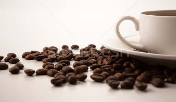 cup of black coffee with roasted coffe beans Stock photo © mizar_21984