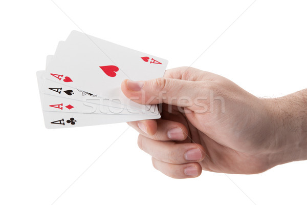 fan of playing card aces in hand on a white background Stock photo © mizar_21984