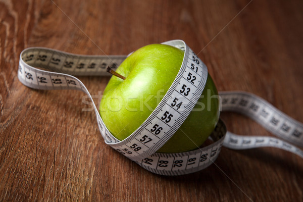 fresh green apple on a wooden table with measure Stock photo © mizar_21984
