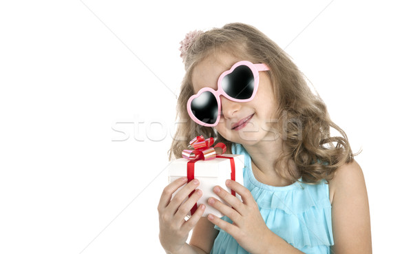 portrait of a little girl in pink sunglasses with gift box Stock photo © mizar_21984