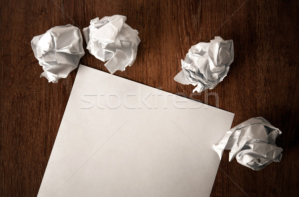 still life of paper and a crumpled paper on a table Stock photo © mizar_21984