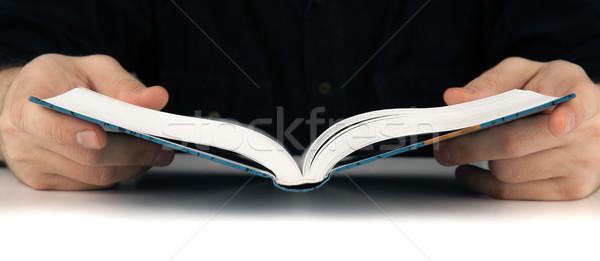 Mãos homem olhando algo livro Foto stock © mizar_21984