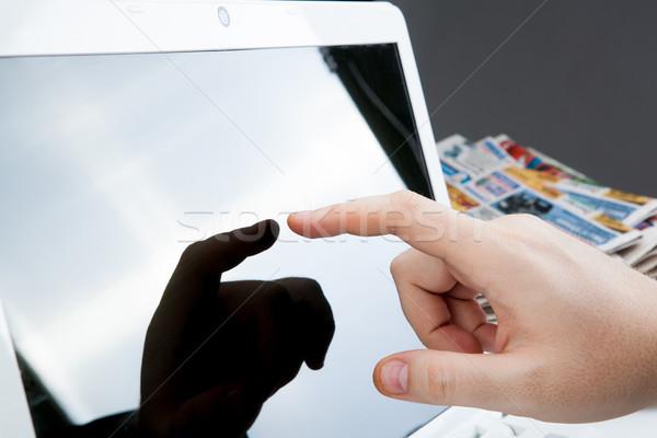 human fingers on the Tablet PC Stock photo © mizar_21984