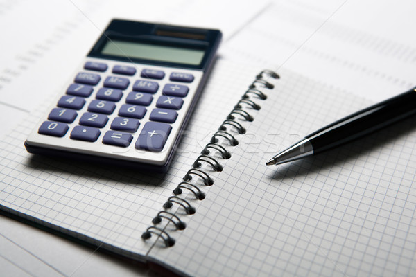 work on the calculator and papers Stock photo © mizar_21984