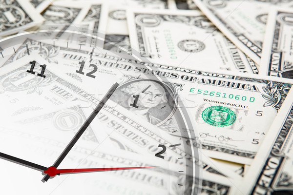clock on the background of banknotes dollars Stock photo © mizar_21984