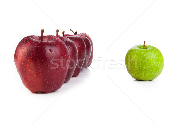 maroon apples lined up in a row and green apple closeup Stock photo © mizar_21984