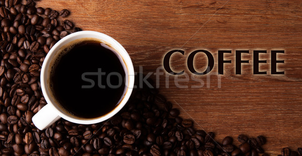 cup of black coffee with roasted coffe beans with title  Stock photo © mizar_21984
