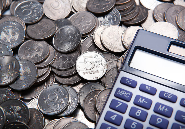 money in the form of coins with calculator Stock photo © mizar_21984
