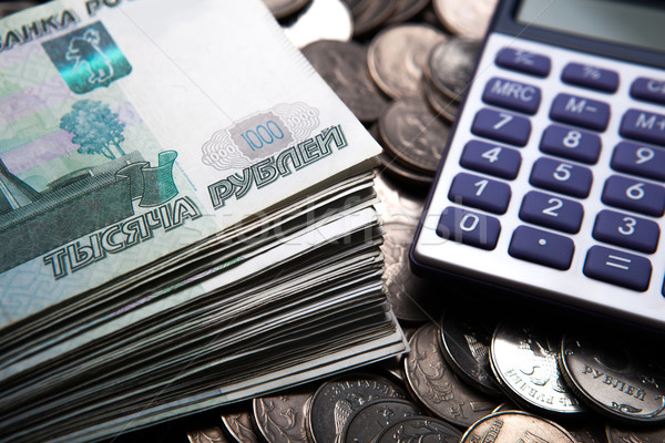 money in the form of banknotes and coins with calculator Stock photo © mizar_21984
