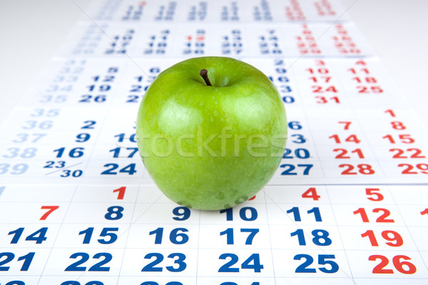 green apple on sheets of wall calendar Stock photo © mizar_21984