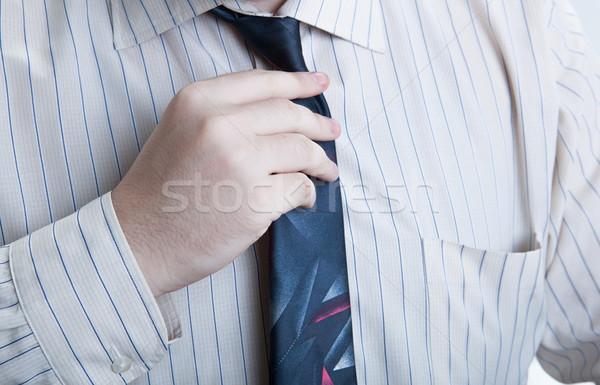 hand business man straightens his tie Stock photo © mizar_21984