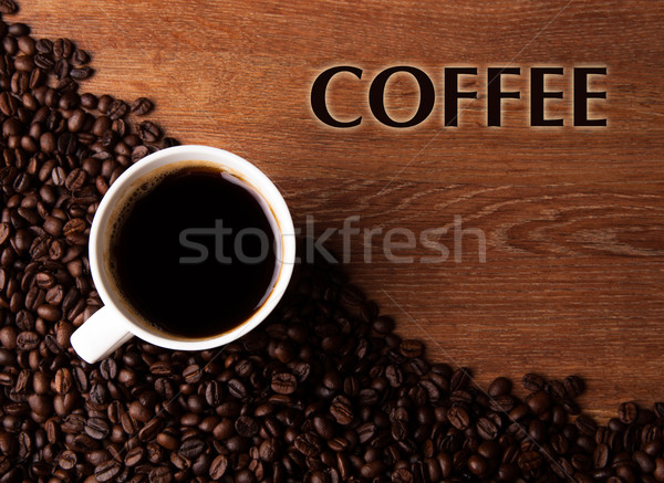 cup of black coffee with roasted coffe beans with title coffee Stock photo © mizar_21984