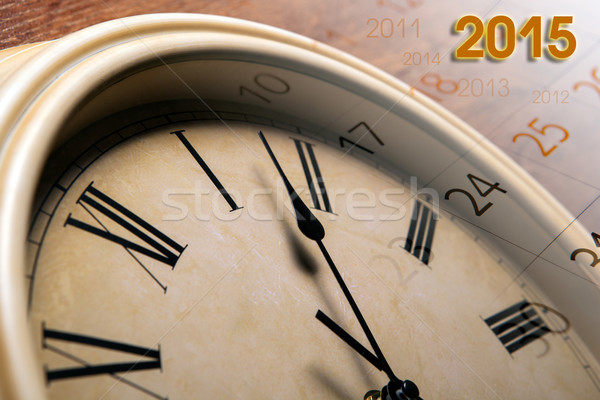 faceclock and sheet of a calendar with the number of days Stock photo © mizar_21984