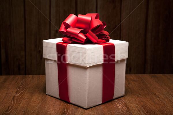 one large white gift box on a wood Stock photo © mizar_21984