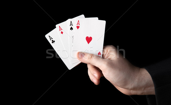 human hand holding four aces Stock photo © mizar_21984