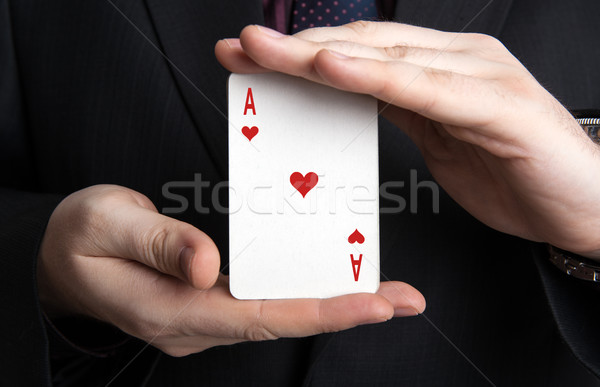 man holding a deck of cards and the ace of hearts Stock photo © mizar_21984