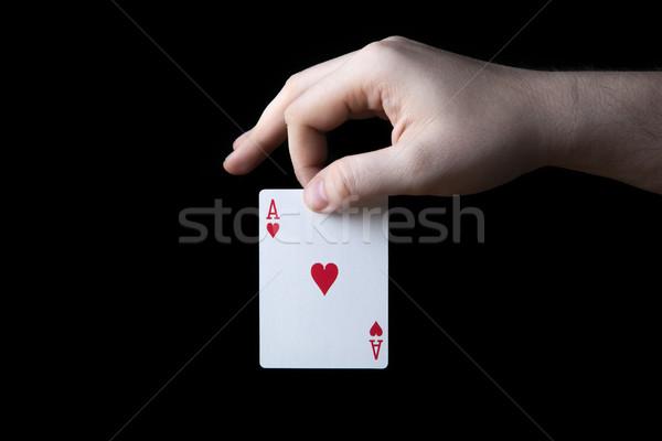 human hand holding the ace of hearts Stock photo © mizar_21984