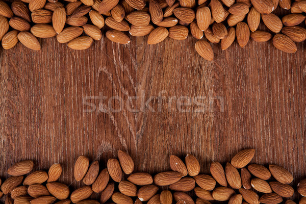 Grain almonds on a wooden background Stock photo © mizar_21984