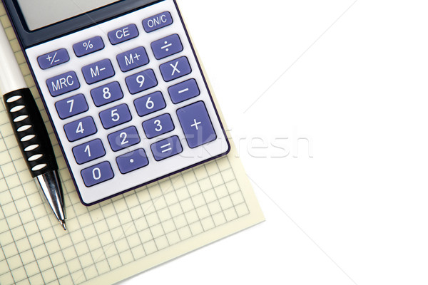 One big calculator with yellow checkbook and stationery on a whi Stock photo © mizar_21984