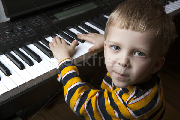 talented little boy sitting at the piano Stock photo © mizar_21984