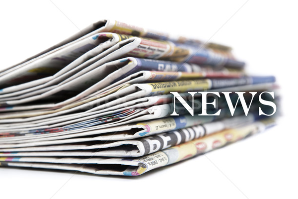4344360_stock-photo-stack-of-newspapers-