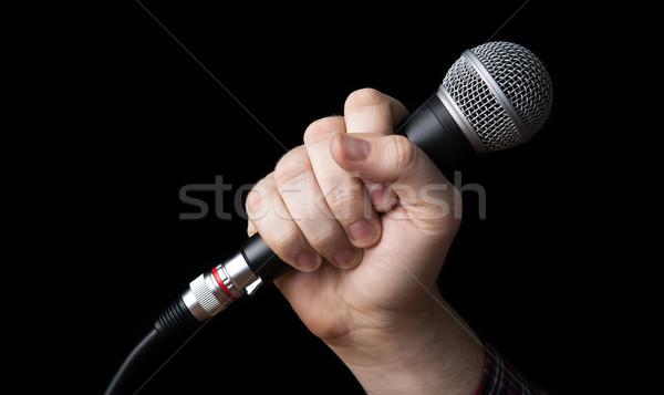 Kéz tart mikrofon fekete technológia művészet Stock fotó © mizar_21984
