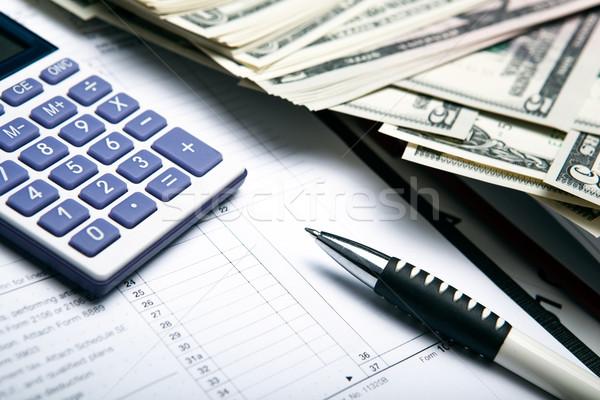 Muhasebe para dolar hesap makinesi çalışmak Stok fotoğraf © mizar_21984