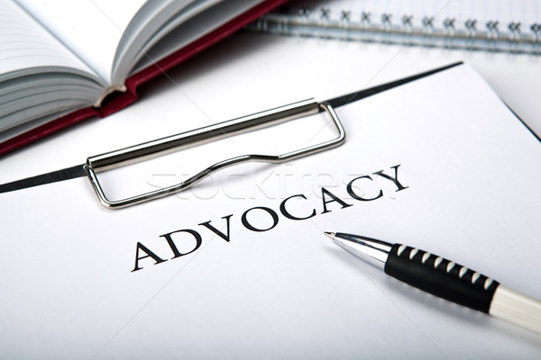 document with the title of advocacy and pen Stock photo © mizar_21984