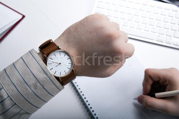 Workplace businessman looks at the clock Stock photo © mizar_21984