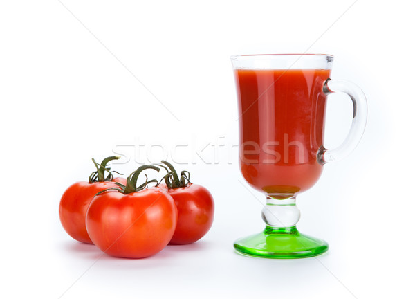 red tomatoes and glass of tomato juice on a white background Stock photo © mizar_21984