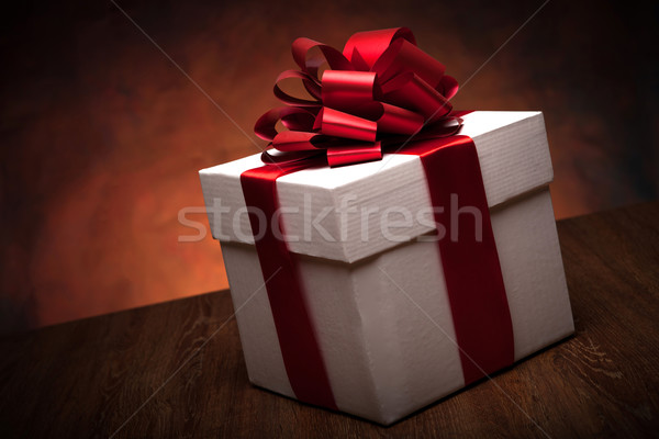 one large white gift box on the wood table Stock photo © mizar_21984