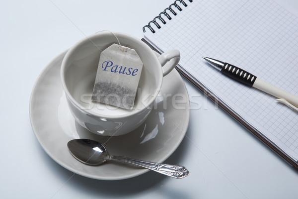 business still-life with with a cup of tea and tea bags Stock photo © mizar_21984