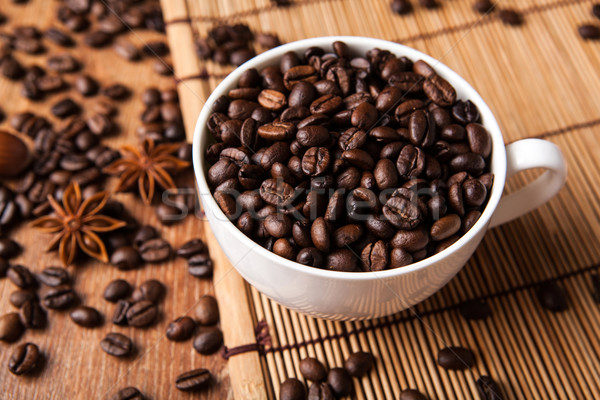 Still-life with a cup of coffee beans Stock photo © mizar_21984
