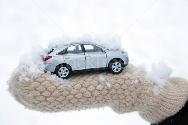 girl holds in her hand model of car with snow Stock photo © mizar_21984
