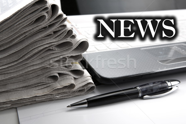stack of newspapers and keyboard close-up Stock photo © mizar_21984