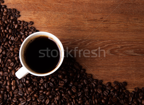 cup of black coffee with roasted coffe beans on the desk Stock photo © mizar_21984