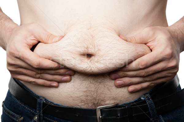 a man feels his fat on his paunch Stock photo © mizar_21984