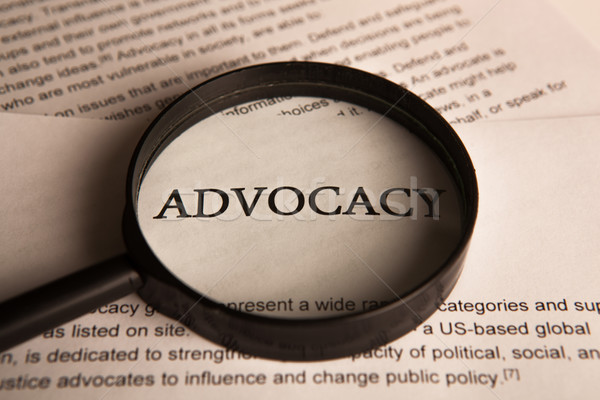 document with the title of advocacy under a magnifying glass Stock photo © mizar_21984