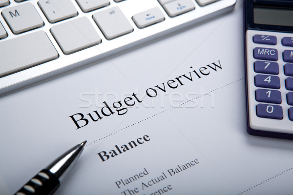 document with title budget overview and keyboard, calculator Stock photo © mizar_21984