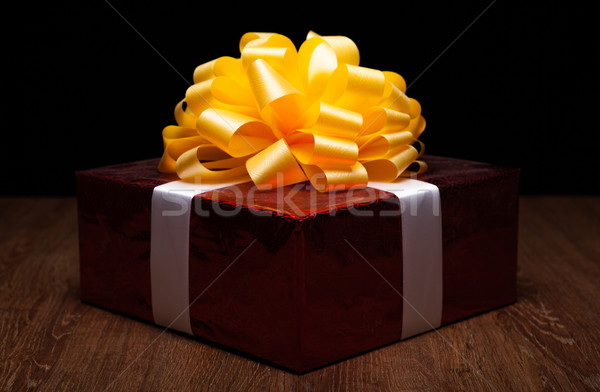 one large red gift box on the wood table Stock photo © mizar_21984