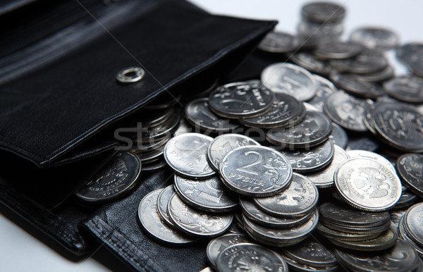 pocket purse with a bunch of Russian coins on a white surface Stock photo © mizar_21984