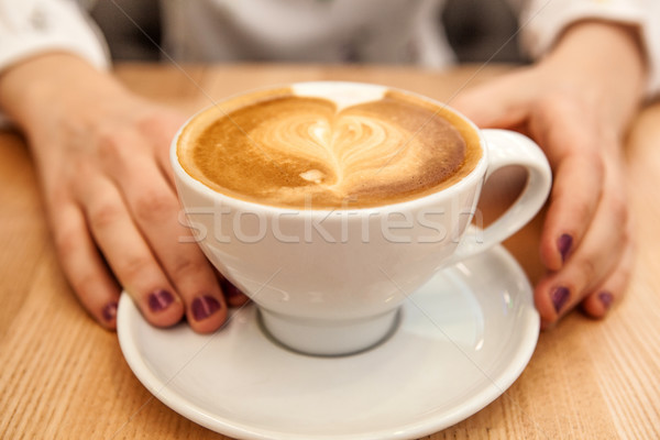 cup cappuccino with foam in the form of a heart and hands Stock photo © mizar_21984