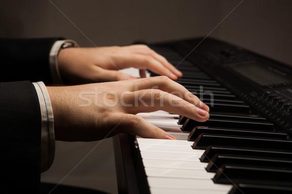 клавиши пианино человека рук музыку человека Сток-фото © mizar_21984