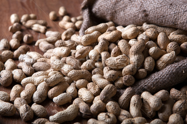 large grains of peanuts in the shell and the bag Stock photo © mizar_21984