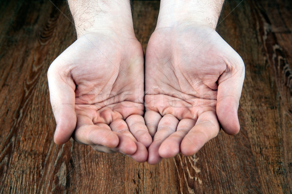 male hands on a wooden background Stock photo © mizar_21984