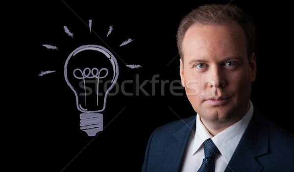 portrait of a man with an idea on a black background Stock photo © mizar_21984