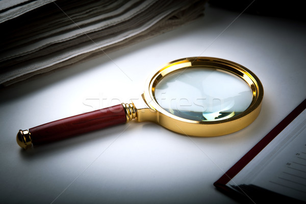 magnifying glass and paper  Stock photo © mizar_21984