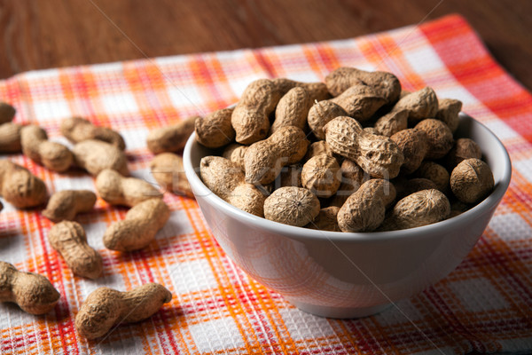 large grains of peanuts in the shell and the bowl Stock photo © mizar_21984