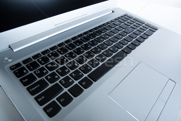 modern gray laptop on a table on close up Stock photo © mizar_21984