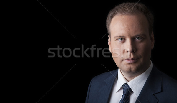 man in a suit and tie on a black background Stock photo © mizar_21984